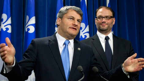 Action Democratique du Quebec Leader Gerard Deltell comments on a members vote to join the Coalition Avenir Quebec (CAQ) as Christian Levesque, president of the ADQ, right, looks on Sunday, Jan. 22, 2012 at the legislature in Quebec City. (Jacques Boissinot / THE CANADIAN PRESS)