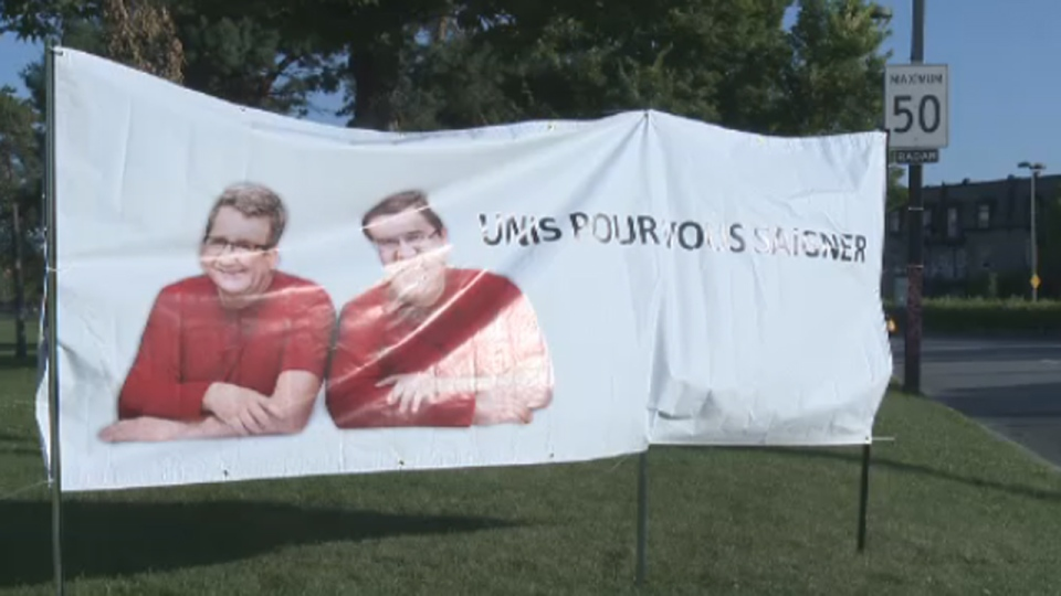 Regis Labeaume and Denis Coderre's campaign for Hema-Quebec is parodied in a banner saying the mayors are planning to bleed workers dry (Aug. 18, 2014)