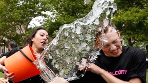 Beryl Lipton, left, douses Matt Lee during the ice bucket challenge to raise funds and awareness for ALS at Boston's Copley Square, Thursday, Aug. 7, 2014. (AP / Elise Amendola)