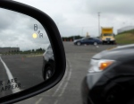 This May 22, 2012 file photo shows a demonstration of a side mirror warning signal in a Ford Taurus at an automobile testing area in Oxon Hill, Md. (AP / Susan Walsh)