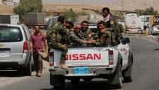 Kurdish forces near dam in Mosul, Iraq