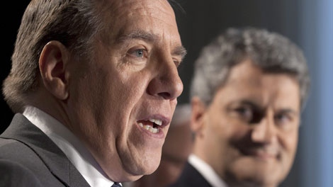 Francois Legault, left, leader of the Coalition Avenir Quebec, announces the Action Democratique du Quebec and his leader Gerard Deltell, right, are joining the CAQ, Tuesday, December 13, 2011 in Quebec City. THE CANADIAN PRESS/Jacques Boissinot
