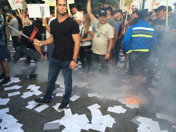 Hundreds of firefighters filled Montreal's city hall Monday in a raucous protest against pension plan changes. (Natalie Nanowski / CTV News)