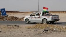 Kurdish forces near Mosul Dam
