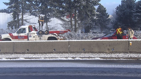 Tow-truck driver Martin Butthof helps a stranded motorist in Richmond, B.C. Jan. 15, 2012. (CTV)