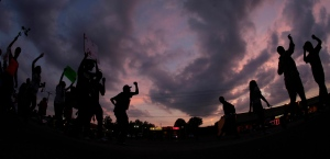 In this photo taken with a fisheye lens, people protest on Monday, Aug. 18, 2014, for Michael Brown, who was killed by police Aug. 9 in Ferguson, Mo. (AP / Charlie Riedel)