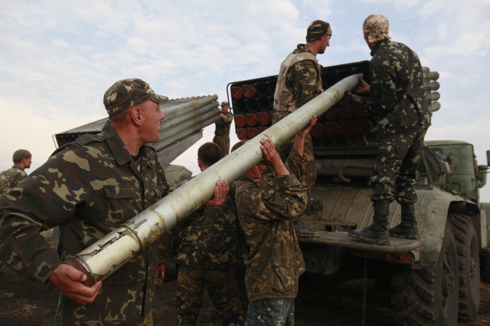 Ukrainian soldiers load a Grad missile during fighting with pro-Russian separatists close to Luhansk, eastern Ukraine on Monday, Aug. 18, 2014. (AP / Petro Zadorozhnyy)