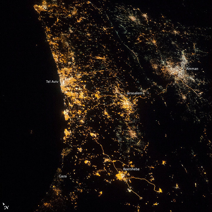 This night photograph taken by astronauts aboard the International Space Station (ISS) shows the location and size of cities at the east end of the Mediterranean Sea. The largest, brightest cluster is the Israeli city of Tel Aviv, a port set against the blackness of the Mediterranean Sea. Jerusalem, Israel's capital city, and Amman, Jordan's capital, are the next largest (with Amman's lights having a whiter tone), followed by Beersheba. (NASA)