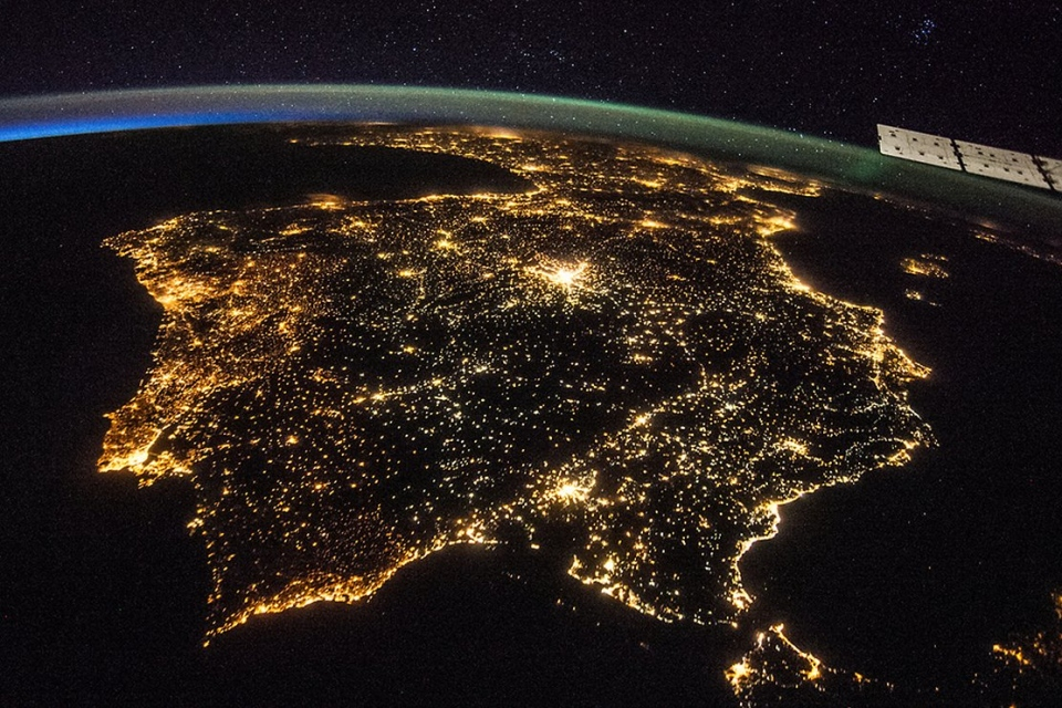 The Iberian Peninsula from space at night, showing Spain and Portugal. Madrid is the bright spot just. (NASA)