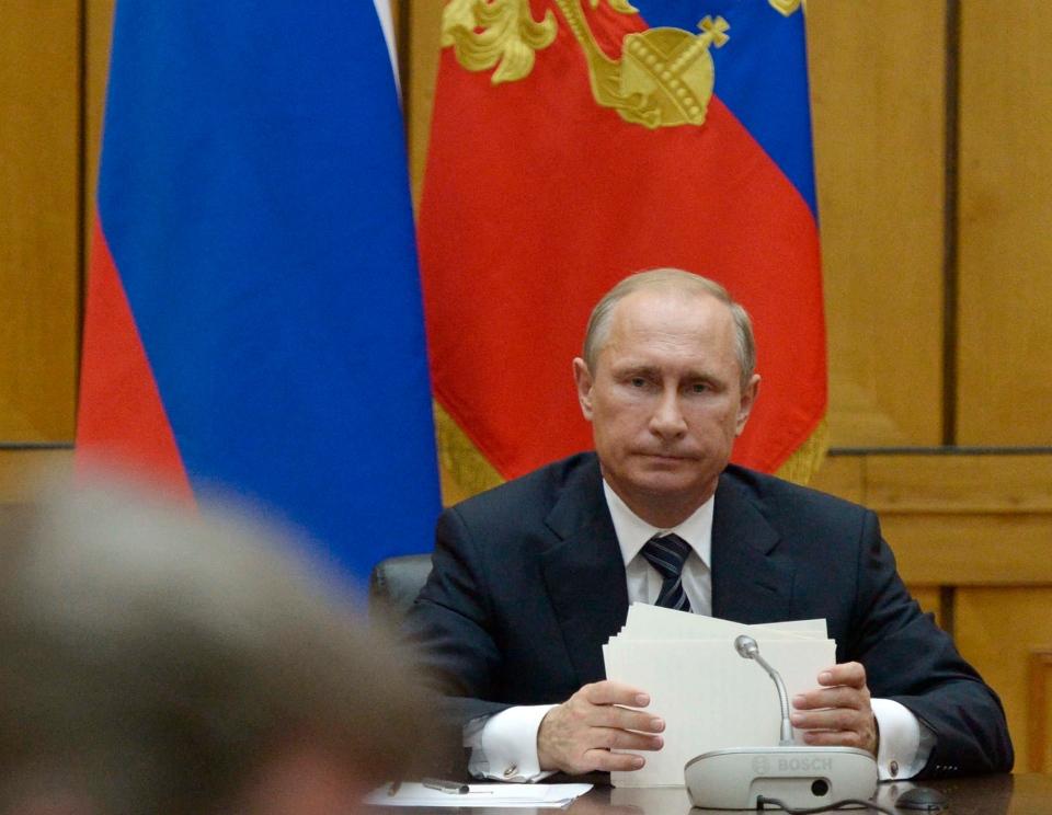 Russian President Vladimir Putin chairs a Security Council meeting in the Black Sea fleet headquarters in Sevastopol, Crimea on Wednesday, Aug. 13, 2014. (AP / RIA-Novosti / Alexei Nikolsky, Presidential Press Service)