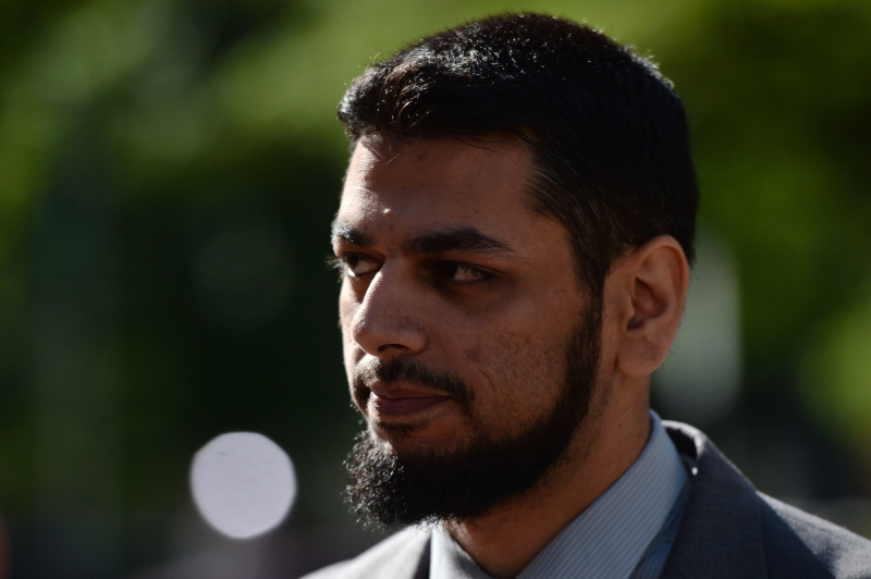 Khurram Syed Sher walks outside court in Ottawa on Tuesday, Aug. 19, 2014. (Sean Kilpatrick / THE CANADIAN PRESS)
