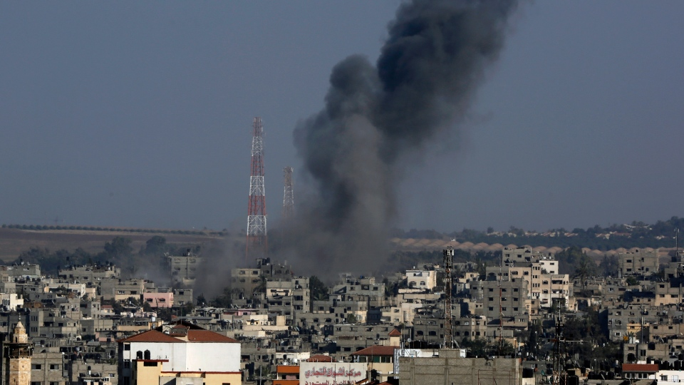 Smoke rises after an Israeli strike hit Gaza City in the northern Gaza Strip, Tuesday, Aug. 19, 2014. (AP / Adel Hana)