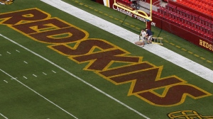 FILE - This Aug. 7, 2014 file photo shows groundskeepers preparing the end zone for the NFL football preseason game between the Washington Redskins and the New England Patriots in Landover, Md. (AP Photo/Alex Brandon, File)