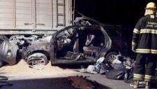 Firefighters inspect the car of Emanuel Bergoglio