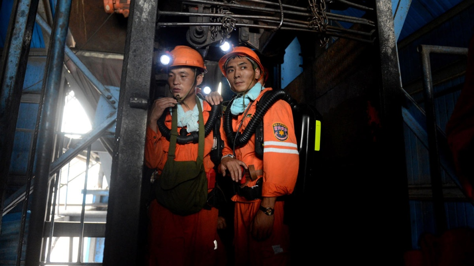 Rescuers prepare to go into the Dongfang Coal Mine in Huainan city, east China's Anhui Province, Tuesday, Aug. 19, 2014. (Xinhua / Zhang Duan)