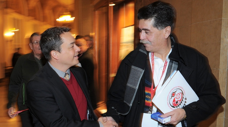 Shawn Atleo, National Chief of the Assembly of First Nations, shakes hands as he arrives to a meeting at the Chateau Laurier during the Crown First Nations Gathering in Ottawa on Monday, January 23, 2012. THE CANADIAN PRESS/Sean Kilpatrick