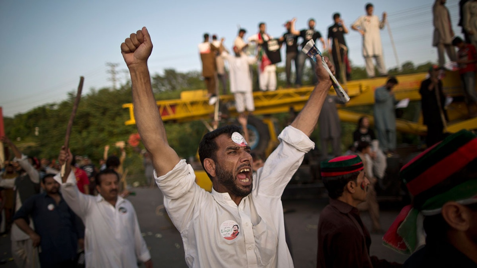 Supporters of Pakistani cricketer-turned-politician Imran Khan shout slogans against Prime Minister Nawaz Sharif in Islamabad, Pakistan, on Aug. 19, 2014. (AP / Muhammed Muheisen)