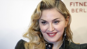 """This Oct. 17, 2013 file photo shows U.S. pop star Madonna at the """"Hard Candy Fitness"""" center in Berlin, Germany. (AP Photo/Michael Sohn)"""