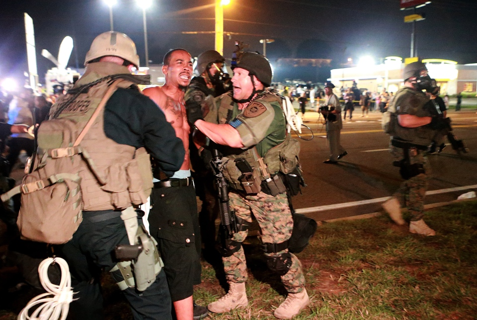 A protestor is detained Monday, Aug. 18, 2014, in Ferguson, Mo. (AP / St. Louis Post-Dispatch, Christian Gooden)