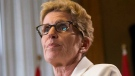 Ontario Premier Kathleen Wynne briefs the media following the Throne Speech at Queens Park in Toronto on Thursday, July 3, 2014. (The Canadian Press/Chris Young)