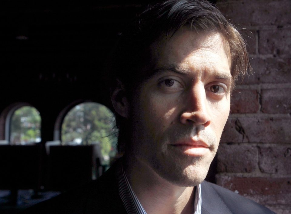 In this May 27, 2011 file photo, American journalist James Foley, of Rochester, N.H., who was last seen on Nov. 22, 2012, in northwest Syria, poses for a photo in Boston. (AP Photo/Steven Senne)
