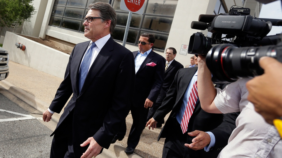 Texas Gov. Rick Perry, left, leaves the Blackwell Thurman Criminal Justice Center after he was booked, in Austin, Texas, Tuesday, Aug. 19, 2014. (AP / Eric Gay)