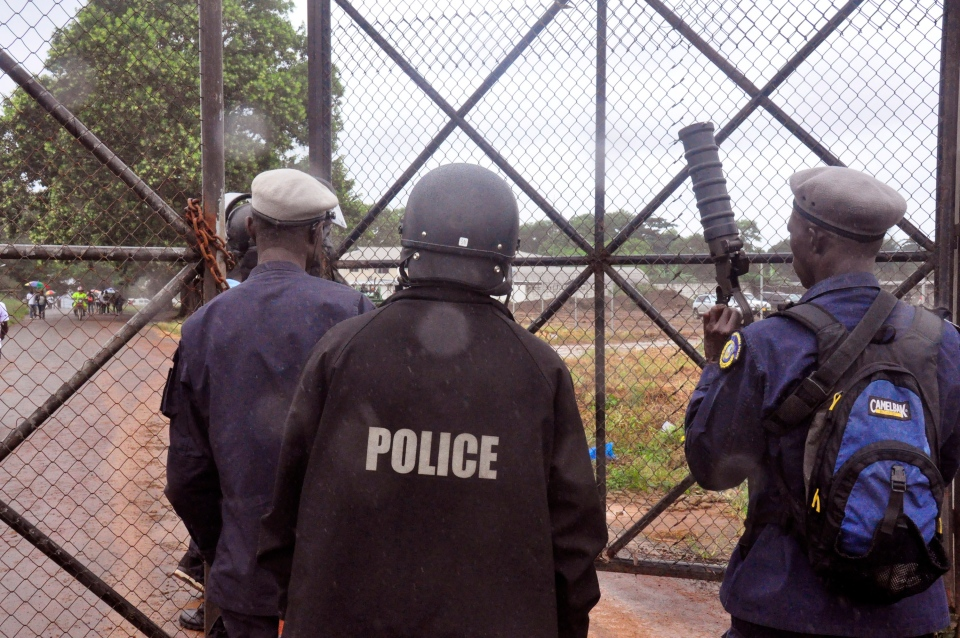 Liberian Police dressed in riot gear deploy at a Ebola treatment centre as they provide security in the city of Monrovia, Liberia on Monday, Aug. 18, 2014. (AP / Abbas Dulleh)