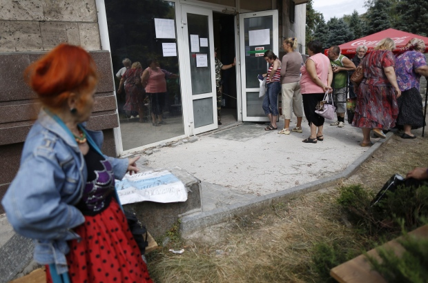 People wait in Donetsk, Ukraine