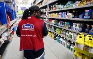 In this Nov. 14, 2011 file photo, a Lowe's employee walks down an aisle in the store in Saugus, Mass. (AP/Michael Dwyer, File)