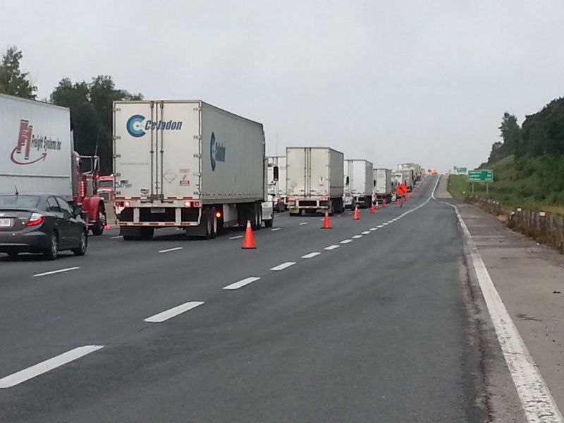 Transport truck traffic on the Highway 401 in Oxford County is backed up following  a collision on Wednesday, Aug, 20, 2014. (Justin Zadorsky / CTV London)