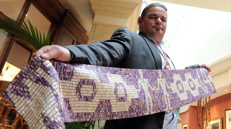 Chief Isadore Day Wiindawtegowinini of the Serpent River First Nations holds up a wampum belt which he will carry as he takes part in Tuesday's ceremony during the Crown First Nations Gathering in Ottawa on Monday, January 23, 2012. The belt symbolizes the historic relationship between the Crown and First Nations. THE CANADIAN PRESS/Sean Kilpatrick