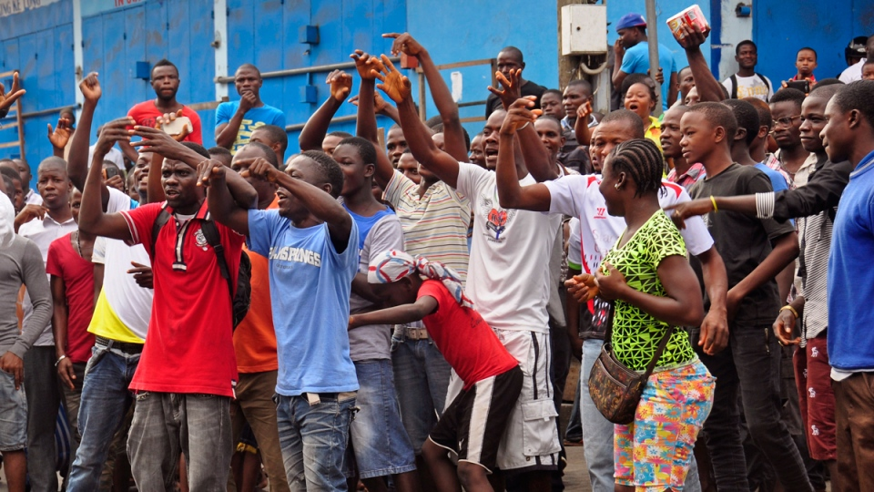 Residents from an area close to the West Point Ebola centre protest after Liberia security forces blocked roads. (AP / Abbas Dulleh)