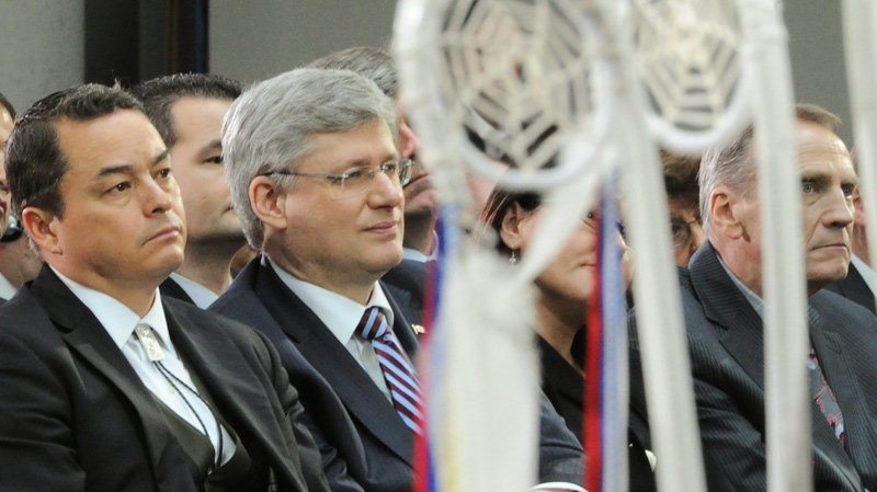 Prime Minister Stephen Harper and Shawn Atleo, National Chief of the Assembly of First Nations, talk as they take part in the Crown First Nations Gathering in Ottawa on Tuesday, Jan. 24, 2012. (Sean Kilpatrick /  THE CANADIAN PRESS)
