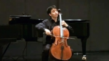 Cellist Stephane Tetreault is seen playing a cello in this undated image taken from video.