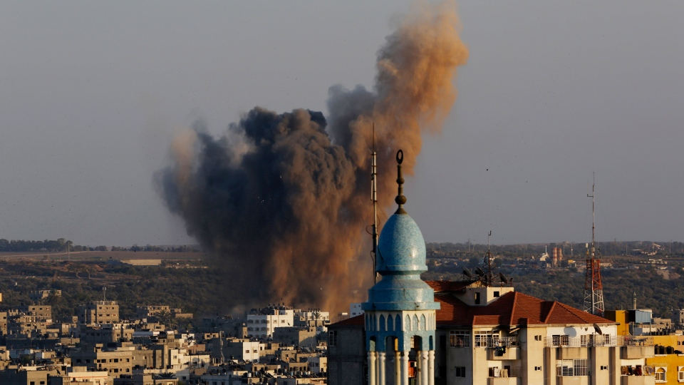 Smoke, dust and debris rise after an Israeli strike hit Gaza City in the northern Gaza Strip, Wednesday, Aug. 20, 2014. (AP / Adel Hana)
