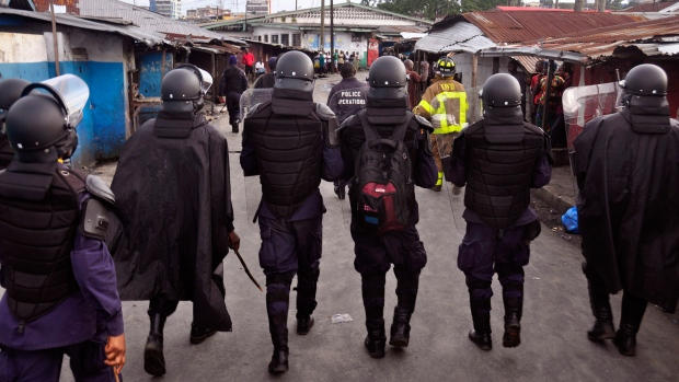 Liberian police seal off slums as Ebola rages