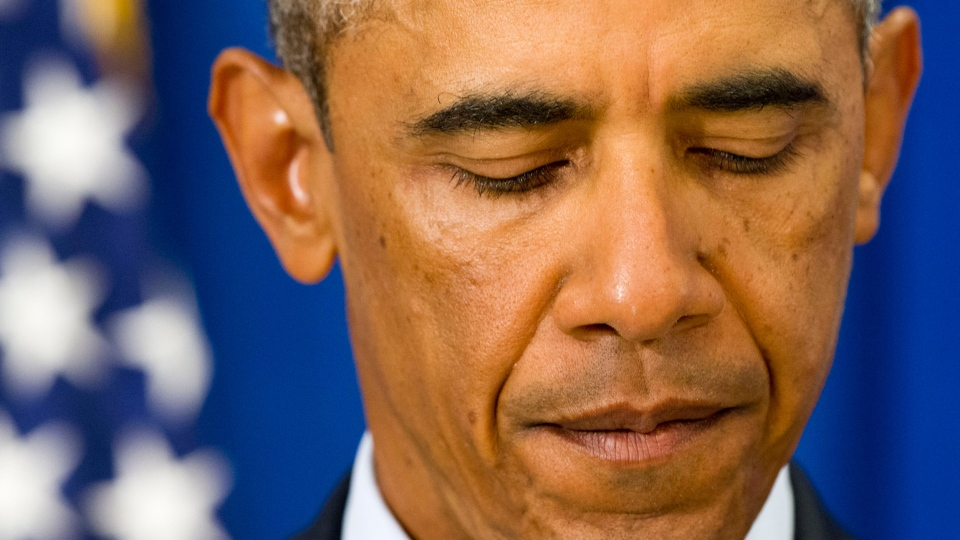 President Barack Obama pauses as he speak in Edgartown, Mass., Wednesday, Aug. 20, 2014, about the killing of American journalist James Foley by militants with the Islamic State extremist group. (AP / Jacquelyn Martin)