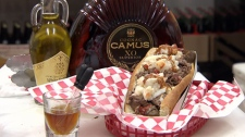 The all new triple-luxury-meat Dragon Dog, infused with top shelf cognac and truffle oil, sells for $100 at Dougie Dog in Vancouver. Jan. 24, 2012. (CTV)