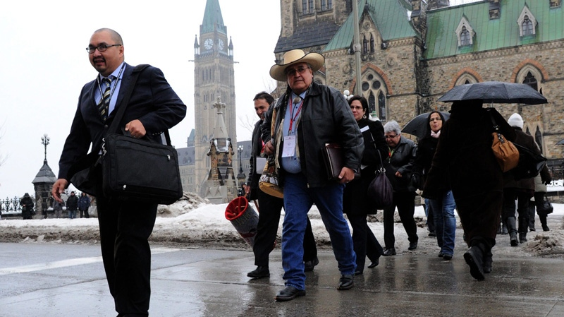 A group of senior chiefs make their way to a meeting with Prime Minister Stephen Harper at the Langevin Block in Ottawa on Monday, Jan. 23, 2012. (Sean Kilpatrick / THE CANADIAN PRESS)