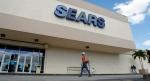 A customer walks towards a Sears store in Hialeah, Fla., Friday, Nov. 9, 2012. (AP / Alan Diaz)