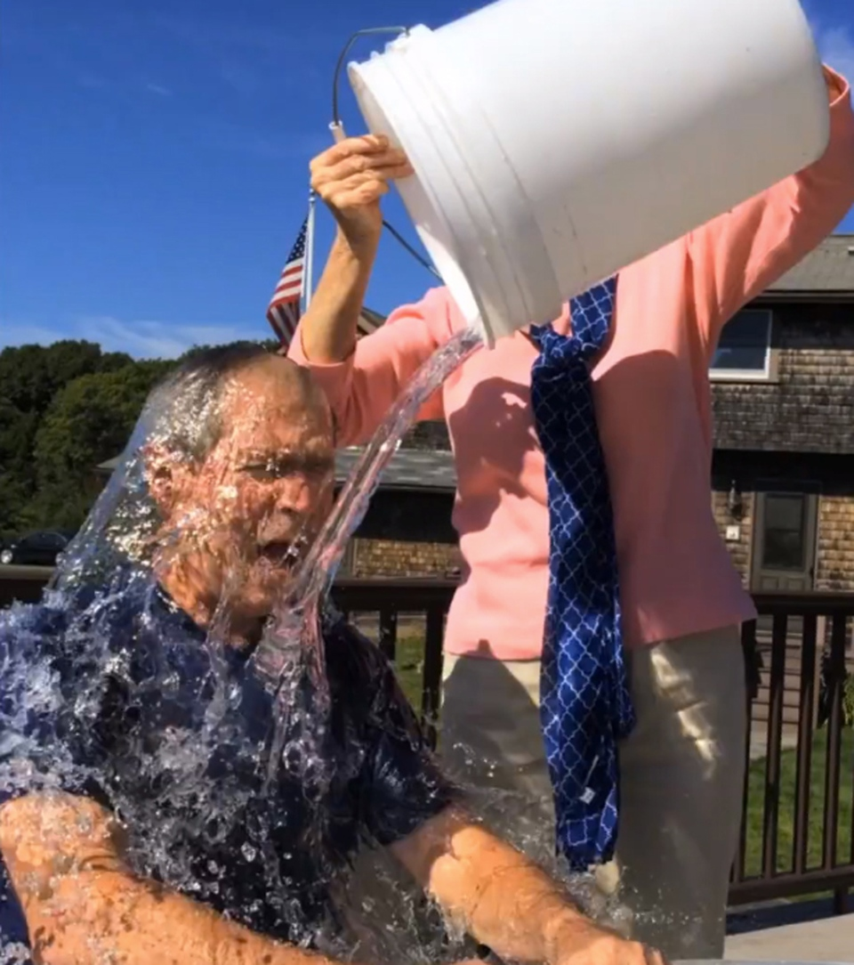 In this image from video posted on Facebook, courtesy of the George W. Bush Presidential Center, former President George W. Bush participates in the ice bucket challenge with the help of his wife, Laura Bush, in Kennebunkport, Maine. The challenge has caught on with notable figures, but U.S. diplomats have been banned from participating. (AP / Courtesy George W. Bush Presidential Center)