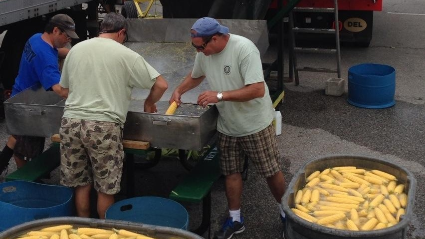 Volunteers prepare corn for the 39th annual Tecumseh Corn Festival on Thursday, Aug. 21, 2014 in Tecumseh, Ont. (Michelle Maluske/ CTV Windsor)