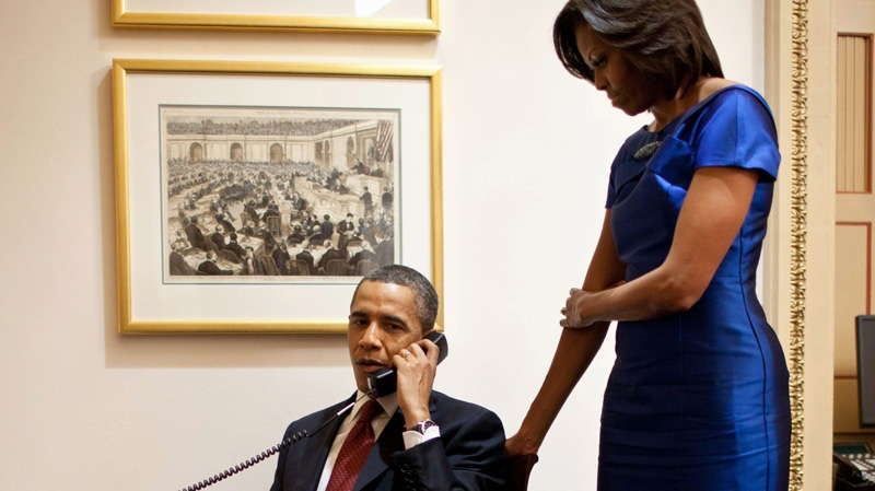 U.S. President Barack Obama, accompanied by U.S. first lady Michelle Obama, is seen during a phone call from the Capitol in Washington, Tuesday, Jan. 24, 2012, immediately after his State of the Union Address, informing John Buchanan that his daughter Jessica was rescued by U.S. Special Operations Forces in Somalia. (Pete Souza, White House)