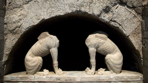 In this handout photo released by the Greek Culture Ministry on Thursday, Aug. 21, 2014, two large stone sphinxes are seen under a barrel-vault topping the entrance to an ancient tomb under excavation at Amphipolis in northern Greece. (AP / Culture Ministry)