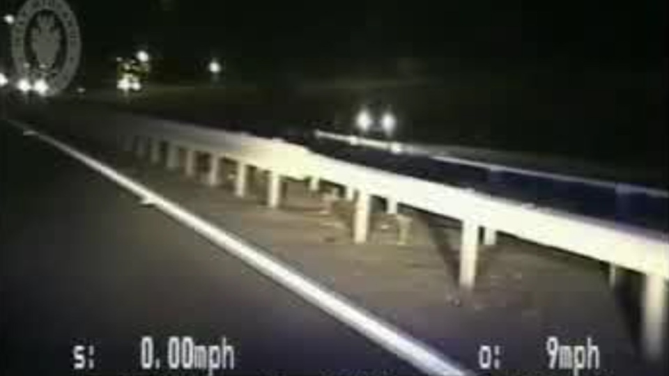 In footage released Thursday, U.K. police stop a speeding car driving the wrong way on the highway by crashing into it with their cruiser. (West Midlands Police / YouTube)