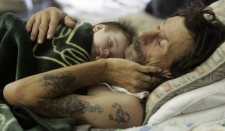 Evacuee Bill Mullins sleeps with his three-month-old son Harley at a shelter in Lufkin, Texas, Monday, Sept. 1, 2008. Mullins and his family left Woodville, Texas to avoid hurricane Gustav. (AP / Pat Sullivan)
