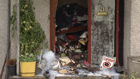 A hoarder was found dead inside this Vancouver home after a fire in October 2011. (CTV)