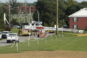 A Campbellsville Fire Department truck with the ladder extended remained at the scene where two firefighters were injured during an ice bucket challenge during a fundraiser for ALS on Thursday, Aug. 21, 2014, in Campbellsville, Ky. (AP / Dylan Lovan)