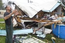 Richard Voisin checks on the damage to his collapsed trailer collapsed that was destroyed during the height of hurricane Gustav in Houma, Louisiana on Monday, Sept. 1, 2008. (Houston Chronicle / Brett Coomer)