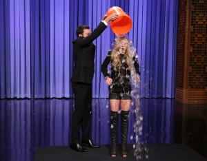 "This Aug. 20, 2014 photo released by NBC shows host Jimmy Fallon, left, dumping a bucket of ice water over the head of actress Lindsay Lohan as she participates in the ALS Ice Bucket Challenge on ""The Tonight Show Starring Jimmy Fallon,"" in New York. (AP Photo/NBC, Douglas Gorenstein)"